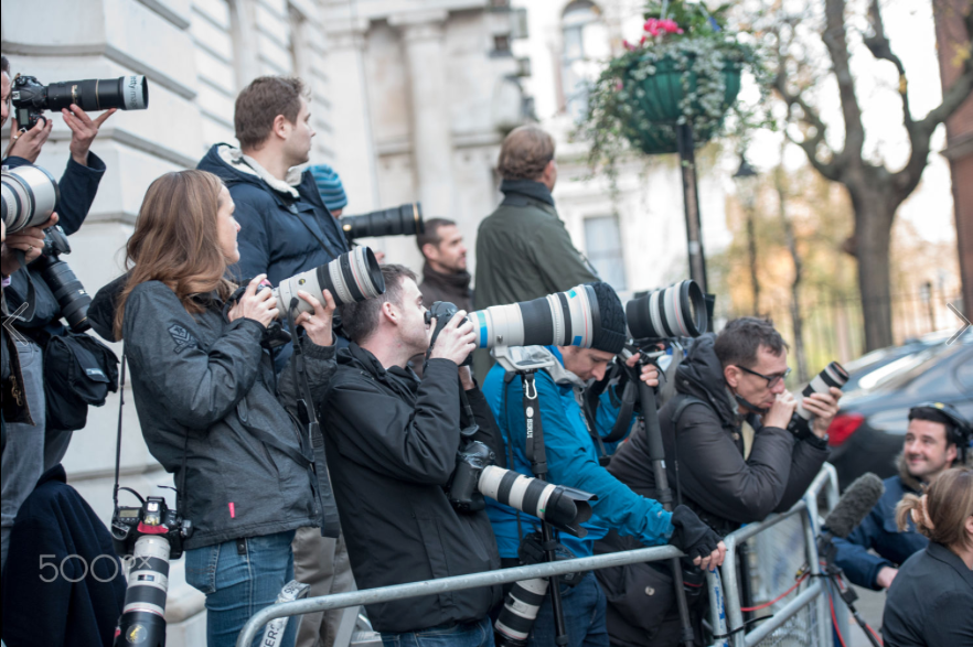 journalists taking photos of an event